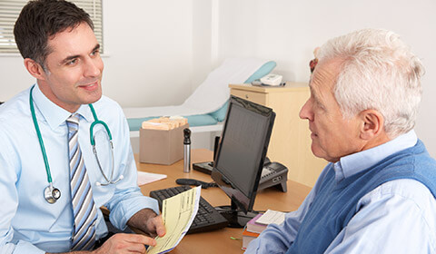 Doctor speaking with patient about concerns