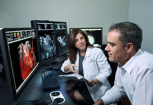 Dr. Yousem reviewing radiology images