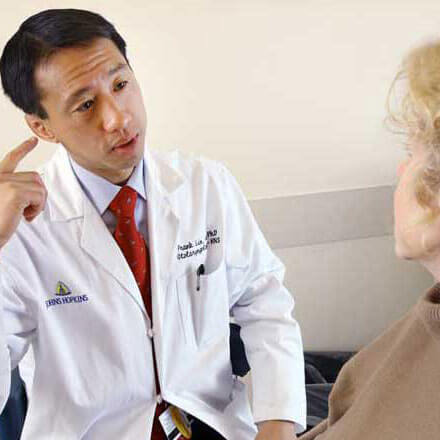 Dr. Frank Lin speaking with a patient.