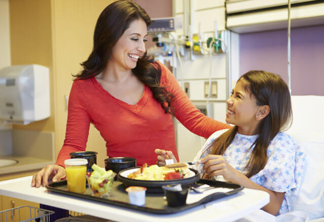 mother and doctor with food service in a hospital room