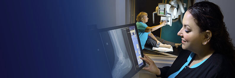 technologist reviewing ankle xray