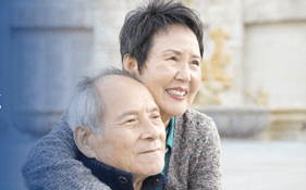 Older asian couple in an embrace