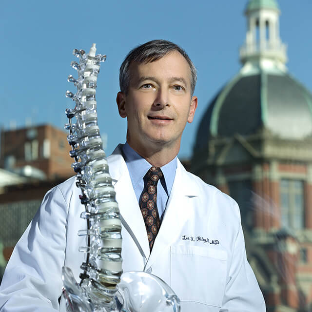 Dr. Riley with a skeleton