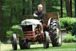 A man driving a tractor