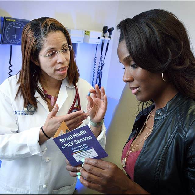 Dr. Renata-Arrington Sanders reviews the PrEP protocol with a patient