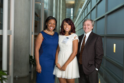 At the recent Henrietta Lacks Legacy event, Dunbar high school senior Rickiya Johnson, center, was awarded a four-year scholarship in Lacks' memory. Johnson is flanked by Dunbar principal Kristina Kyles and Dan Ford, vice dean for clinical investigation.