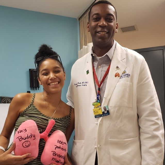 Photo shows Brianna Fogelman with transplant surgeon Errol Bush