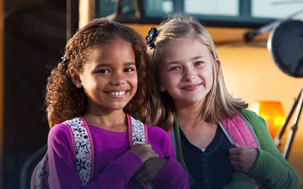Two students waiting for the bus together.