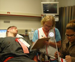 Nurse Taryn Giza (center) from the Emergency and Trauma Department cares for a mock patient.