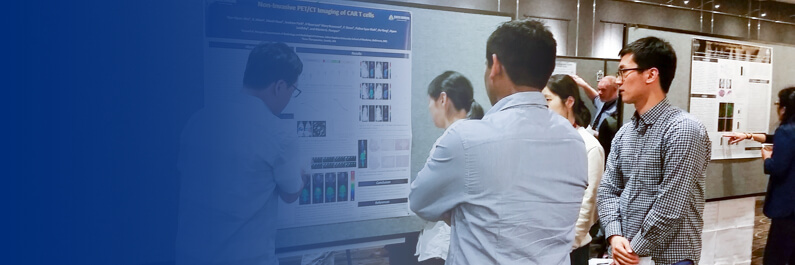 image of people gathered around a research poster