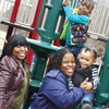 Noy Brown and Aisha Frisby with daughters Marley and Karter on playground