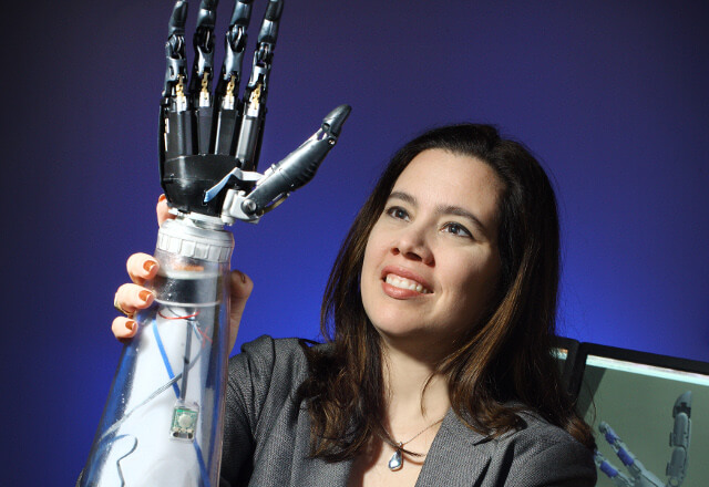 Amputee rehab expert Dr. Gonzalez holding a robotic arm