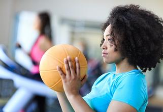 Young woman holding basketball