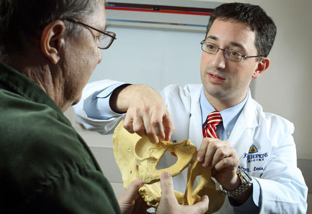 Orthopaedic Oncologist Adam Levin, M.D. with a patient