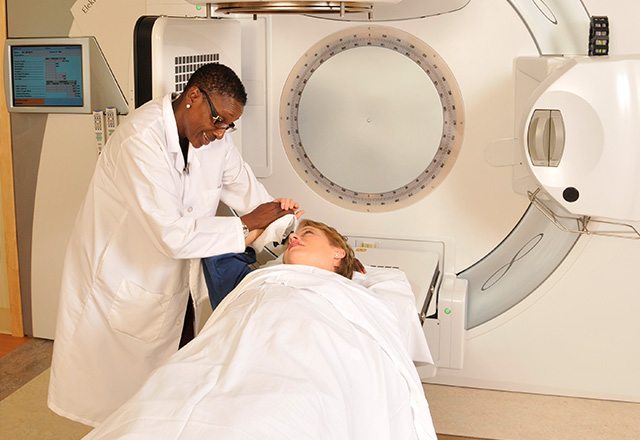 Doctor tending to patient before a scan