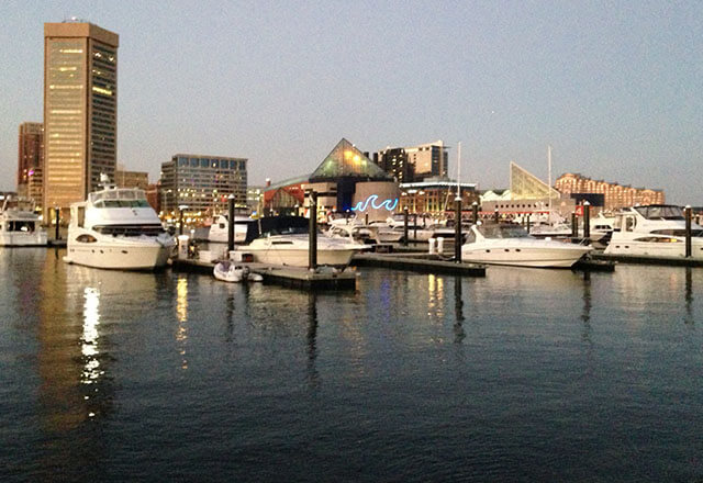 Baltimore Harbor scene including boats and the aquarium