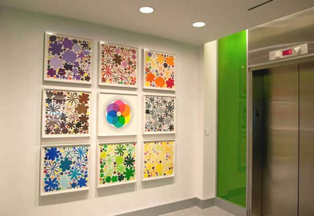 an art display of a grid of nine works