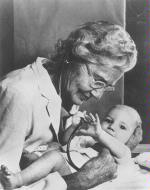 Photo of Dr. Helen Taussig examining an infant.