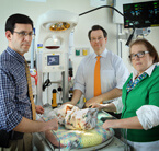 Pediatric neurologist Adam Hartman, neuroradiologist Thierry Huisman and neonatologist Frances Northington, co-directors of the NICN, consult over the care of a newborn