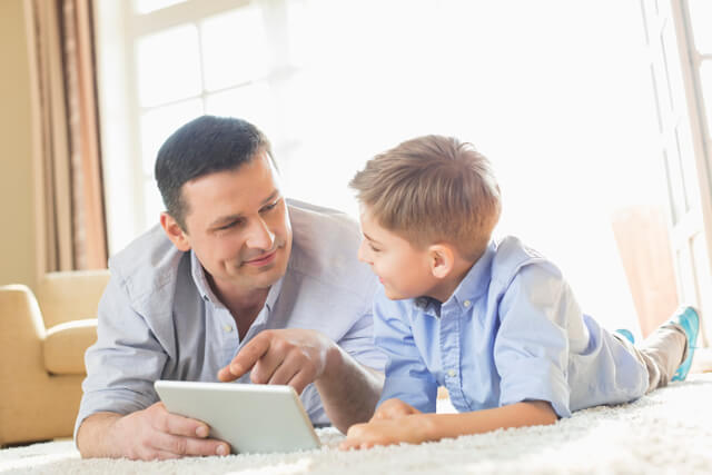 Boy and father using tablet