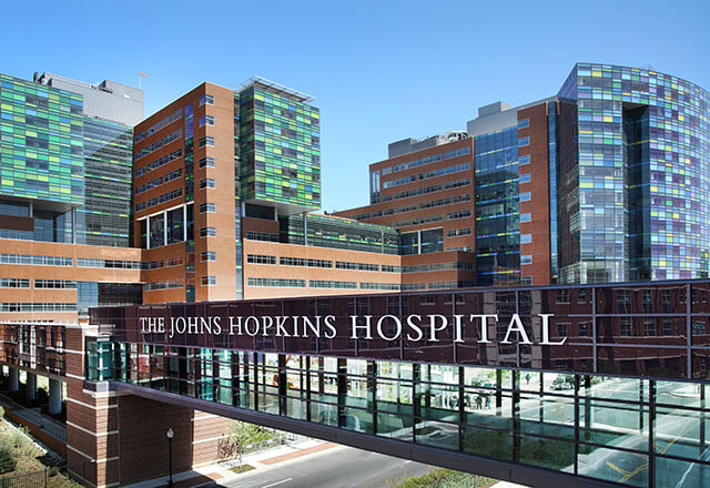 Bloomberg building with Johns Hopkins Hospital sign