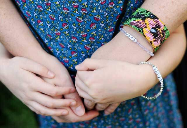 Danica and her mom wear matching bracelets symbolizing hope and trust