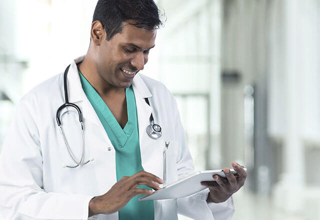 male physician working on ipad
