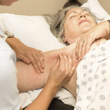 Woman undergoing a procedure for lymphedema