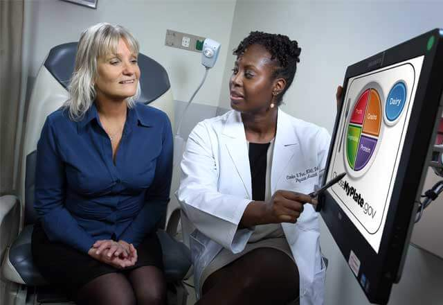 nurse shows patient image on screen