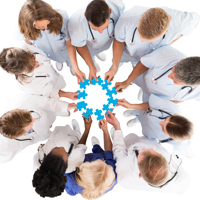 Image shows clinicians piecing together a jigsaw puzzle.
