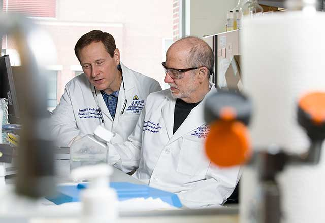 Dr. Bert Vogelstein with Scientist in lab