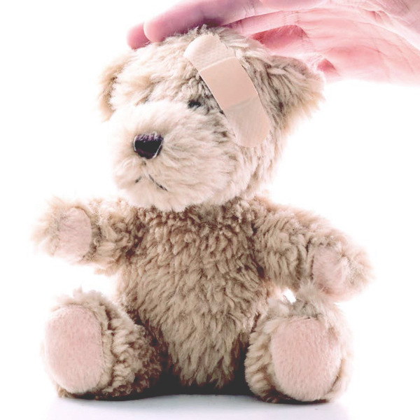 Teddy bear with a band-aid on its forehead