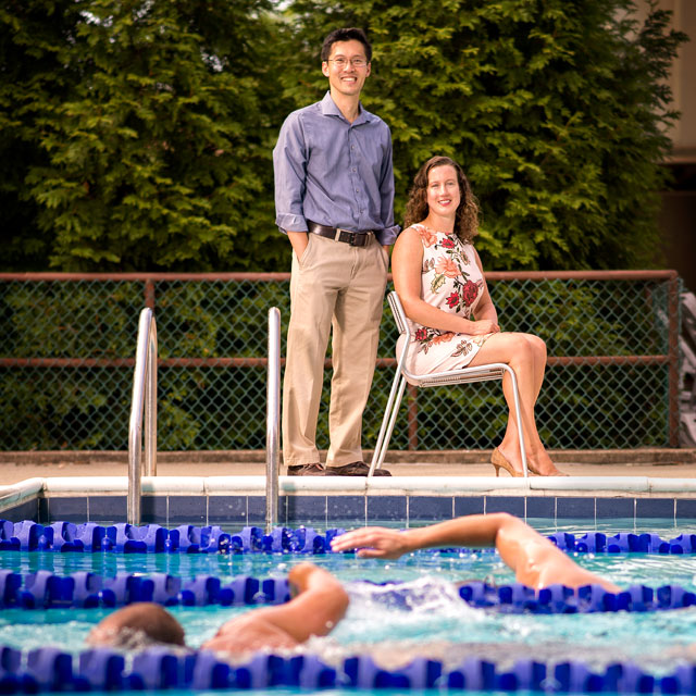 Ying Wei Lum and Holly Grunebach watching swimmers