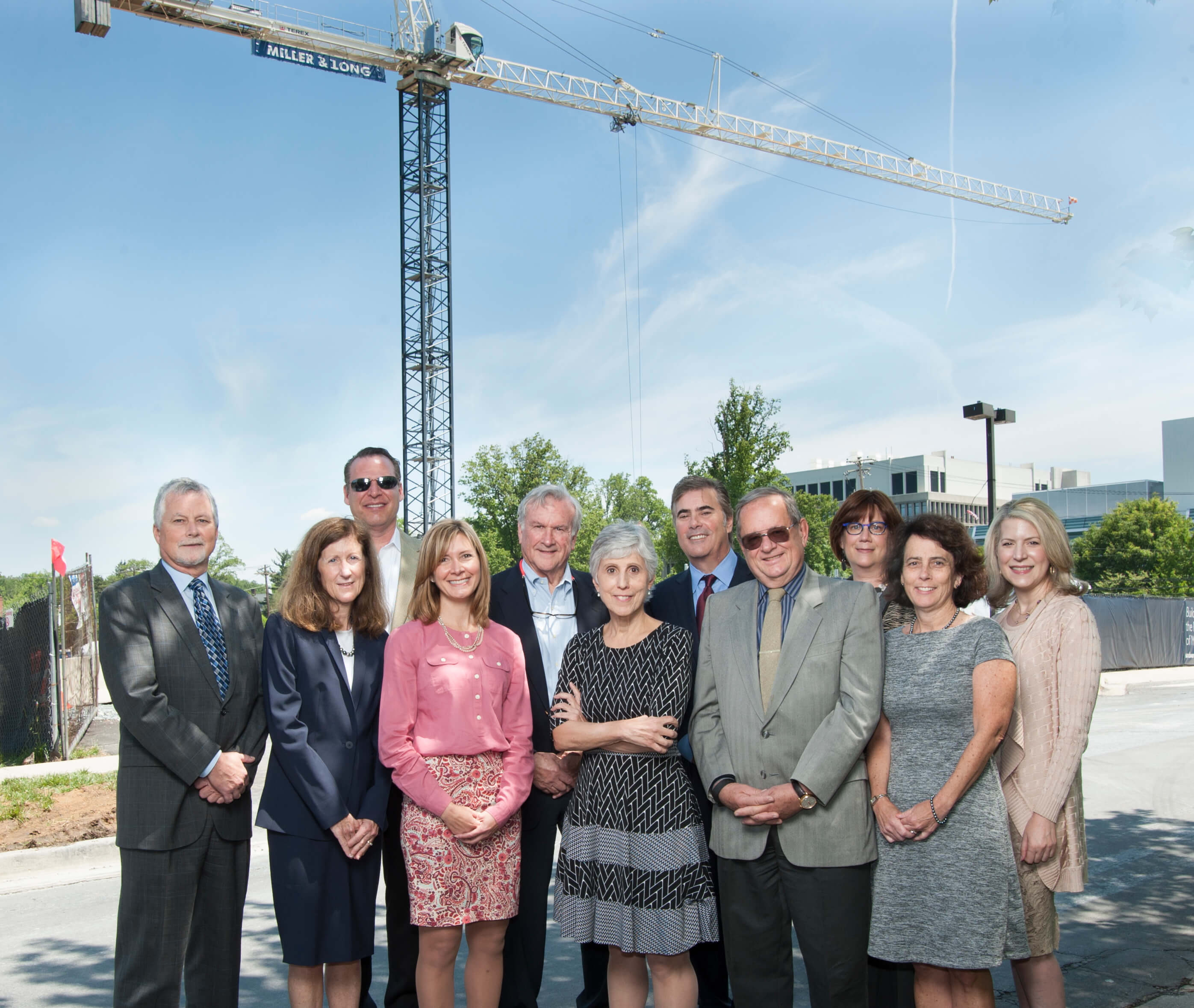 Executives and board members at the crane event