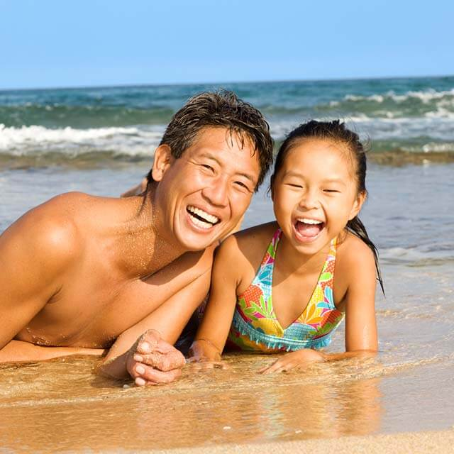 Father and daughter enjoying time on the beach