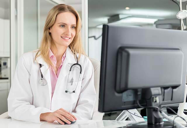 Stock photo of physician watching webinar