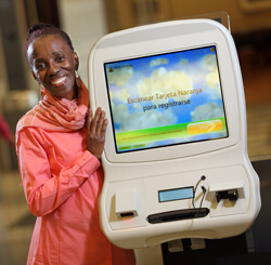 Most days, Alethia Boone helps patients register on the Harry and Jeanette Weinberg Building's electronic kiosks.