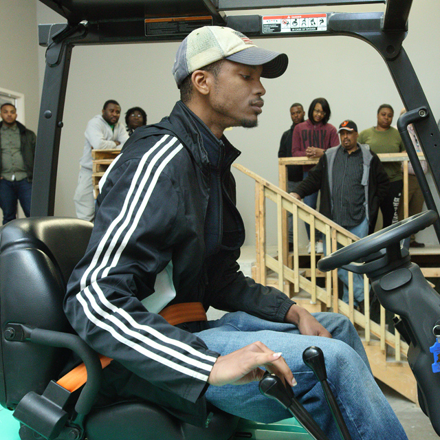The photo shows Darien Porter on a forklift.