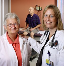 Nurse manager Anita Reedy (left) and oncologist Hetty Carraway (right) care for immune-suppressed patients, which is ample reason to get the flu vaccine.