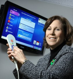 Mary Margaret Jacobs demonstrates an interactive television system allowing patients to search for their providers' names, titles and photos.