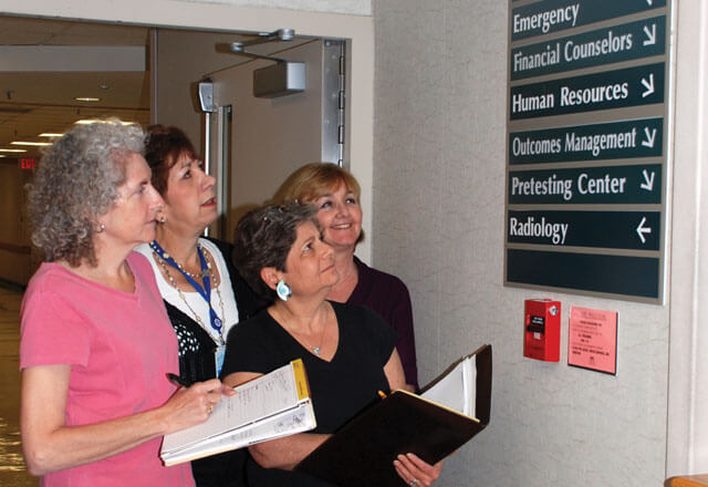 Four women observing hospital signage at Suburban Hospital