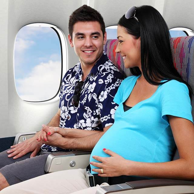 Pregnant woman seated aboard a plane