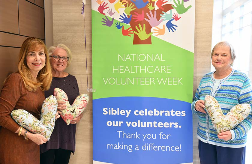 volunteers with heart-shaped pillows
