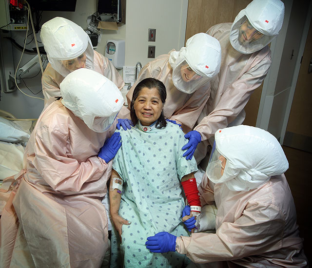 patient Neddie Burwell surrounded by her rehabilitation team