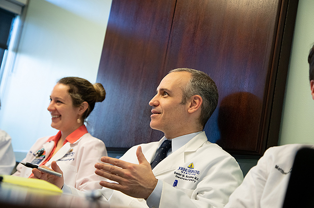 Physicians at a Spinal Tumor meeting.