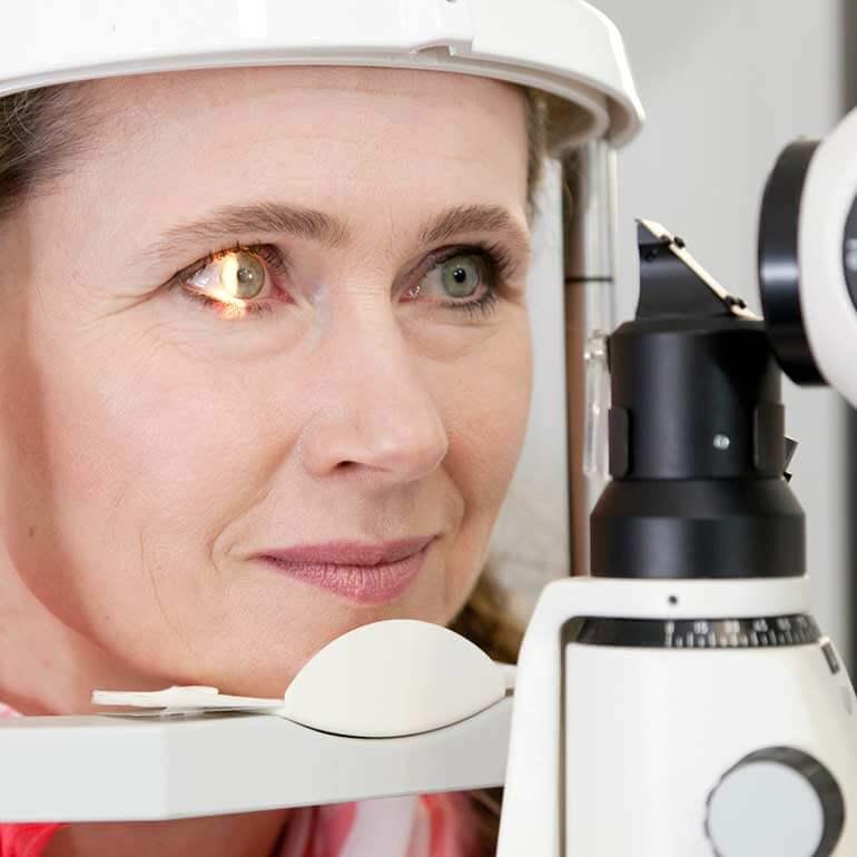 Woman receiving an eye exam.