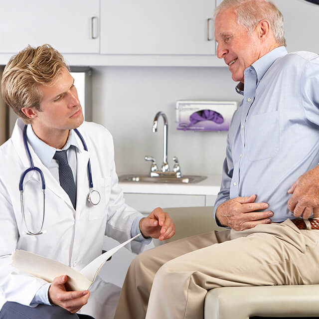 Male patient listens to doctor's instructions