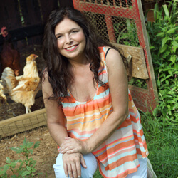 Eva Sherman Hejazi posing at her home in front of her chicken coop