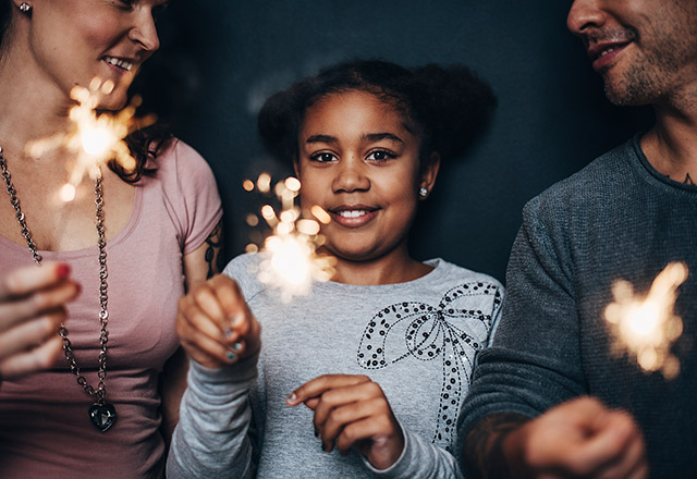 Young girl with a sparkler.