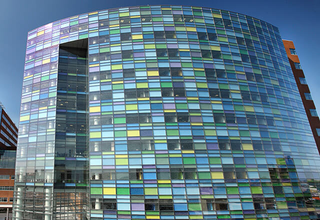 Johns Hopkins Children's Center exterior view of multicolored, glass building.
